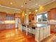 Spacious kitchen interior with kitchen island in luxury house worth $1 million dollars
