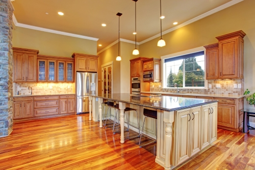 Spacious kitchen interior with kitchen island in luxury house worth $1 million dollars